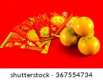 four oranges and red envelope... | Shutterstock . vector #367554734