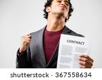 Small photo of this guy finally has a contracts in his hands because he was hired or he had a good deal