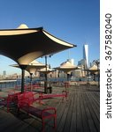 Small photo of View of Manhattan, New York, NY from J. Owen Grundy Park in Exchange Place in Jersey City, NJ.