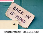 Small photo of Back in 15 minutes sign on doorway of business