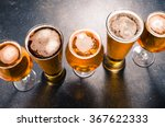 beer glasses on dark table | Shutterstock . vector #367622333