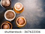 Stock photo beer glasses on dark table 367622336