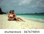 he and she on the beach | Shutterstock . vector #367674854