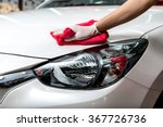 Stock photo car detailing series worker cleaning white car 367726736
