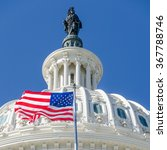 Stock photo us capitol dome detail with waving national flag 367788746