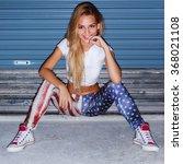 pretty young blonde girl night... | Shutterstock . vector #368021108