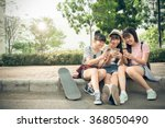 laughing girls playing on their ...   Shutterstock . vector #368050490