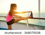 fitness girl stretching leg on... | Shutterstock . vector #368070038