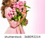 Stock photo woman with spring flower bouquet happy surprised model woman smelling flowers mother s day 368092214