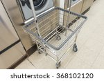 laundry machine and a cart in