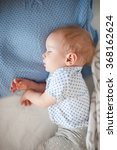 sleeping baby boy in bed. top... | Shutterstock . vector #368162624