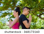 Постер, плакат: Young couple meditating and