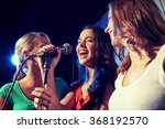 happy young women singing... | Shutterstock . vector #368192570