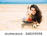 cheerful and beautiful young... | Shutterstock . vector #368245058