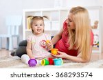 child girl and mother playing... | Shutterstock . vector #368293574