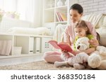 pretty young mother reading a... | Shutterstock . vector #368350184