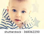 A Cute White Baby Boy With Big...
