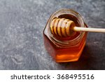 honey in a pot or jar on... | Shutterstock . vector #368495516