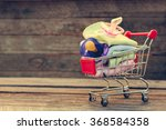 shopping cart with clothing and ... | Shutterstock . vector #368584358