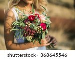 The Bride In A White Dress Wit...