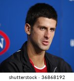 NEW YORK - SEPTEMBER 9: Novak Djokovic attends press conference after the victory against Fernando Verdasco of Spain at quarterfinal match at US Open on September 9 2009 in Flushing, New York. - stock photo