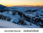 few houses of village on hillside in mountain area in morning light - stock photo