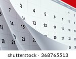 Pages Of A Red Calendar With...