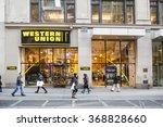 Small photo of New York, New York, USA - January 27, 2016: The exterior of a Western Union store on Broadway above 40th street in Manhattan. Pedestrians can be seen.