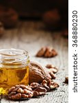 walnut oil in a small jar and... | Shutterstock . vector #368880230