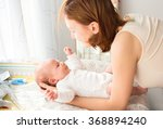 mother gently care of baby on... | Shutterstock . vector #368894240