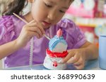 close up of  kid painting color ... | Shutterstock . vector #368990639