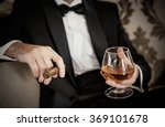 Gentleman Holding Glass Of...