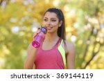 young beautiful woman drinking... | Shutterstock . vector #369144119