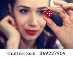 Cheerful Girl Holding A Red...