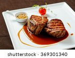 Filet mignon with red wine sauce, mustard and cherry