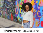 Woman Posing By Graffiti At...