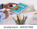 businessman working on tablet... | Shutterstock . vector #369327383