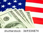 american dollars and flag.... | Shutterstock . vector #369334874