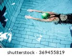Fit Woman Swimming With...
