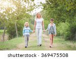 family walking in the summer... | Shutterstock . vector #369475508