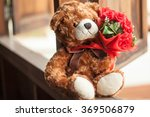 Stock photo smiling teddy bear holding beautiful red roses bouquet 369506879
