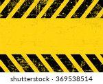 a grungy and worn hazard... | Shutterstock .eps vector #369538514
