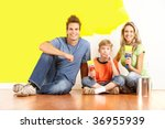 Smiling Young Family Painting...