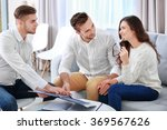 estate agent presenting new... | Shutterstock . vector #369567626