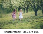 sisters playing and running in... | Shutterstock . vector #369575156
