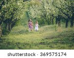 sisters playing and running in... | Shutterstock . vector #369575174