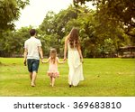 family walk in the park  happy... | Shutterstock . vector #369683810
