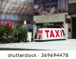 Urban Red Taxi Close Up Sign....