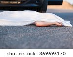 Small photo of Body of a young child covered by a sheet lying on the street in front of the bumper of the car that ran him over with foreground copy space