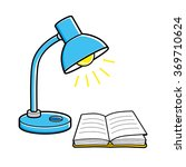 Blue Desk Lamp And An Open Book.